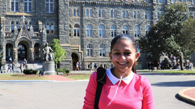 Shavini Fernando in front of Healy Hall