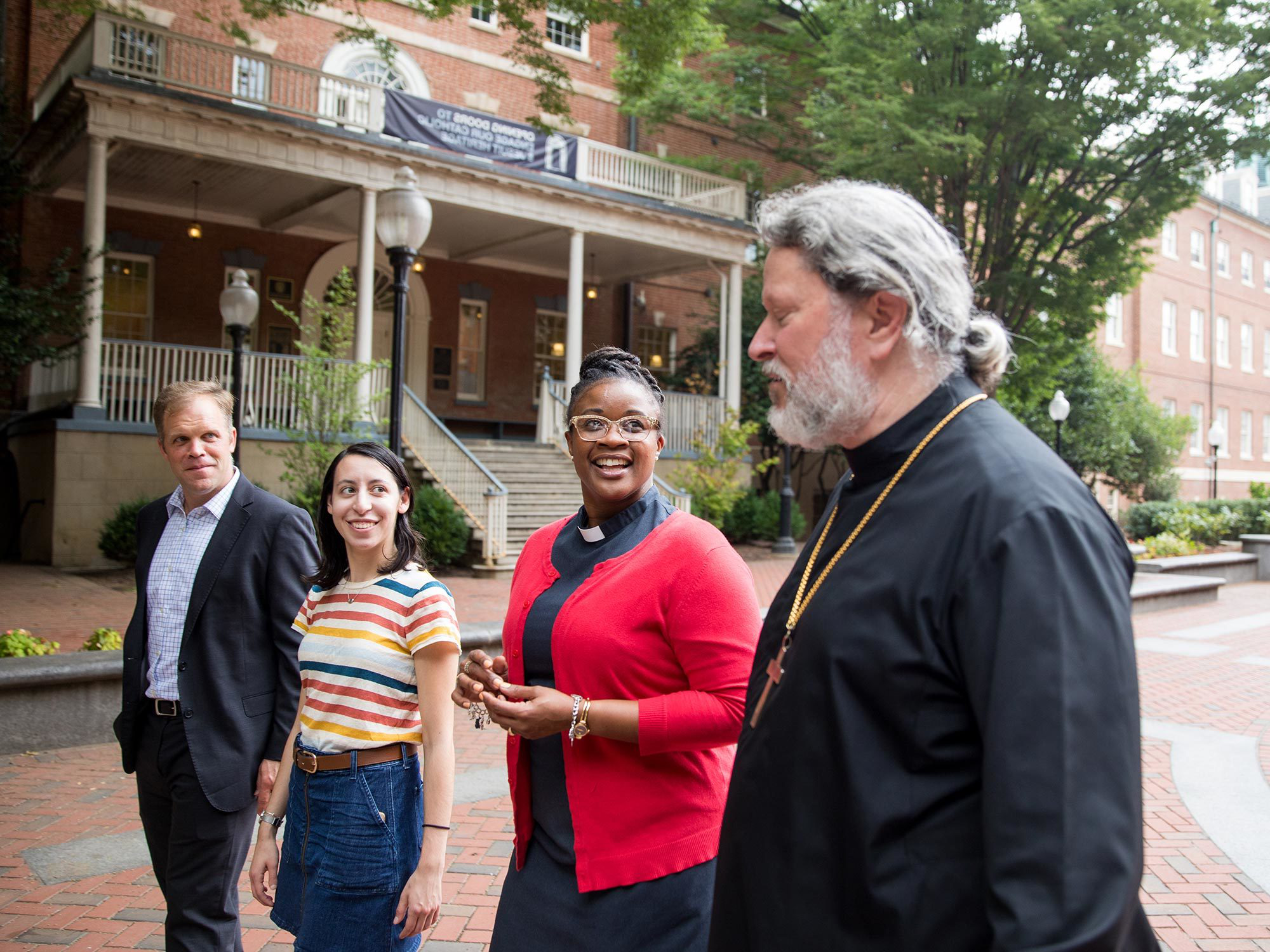 Chaplains walk with a student on campus