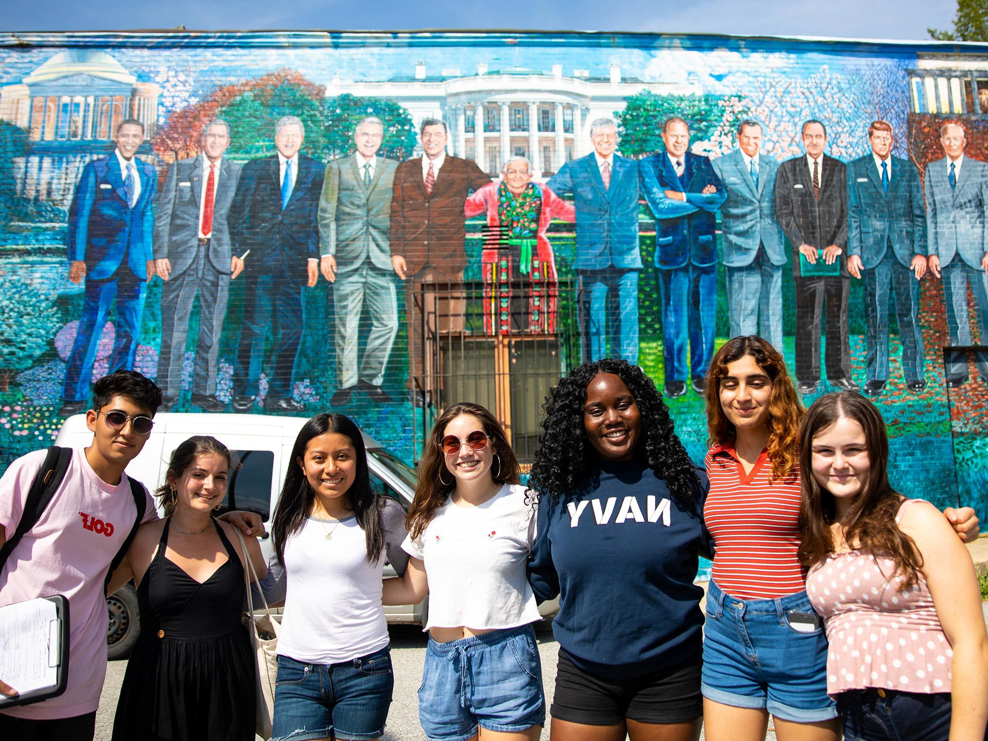Georgetown students go on a service trip in DC and pose for a photo.